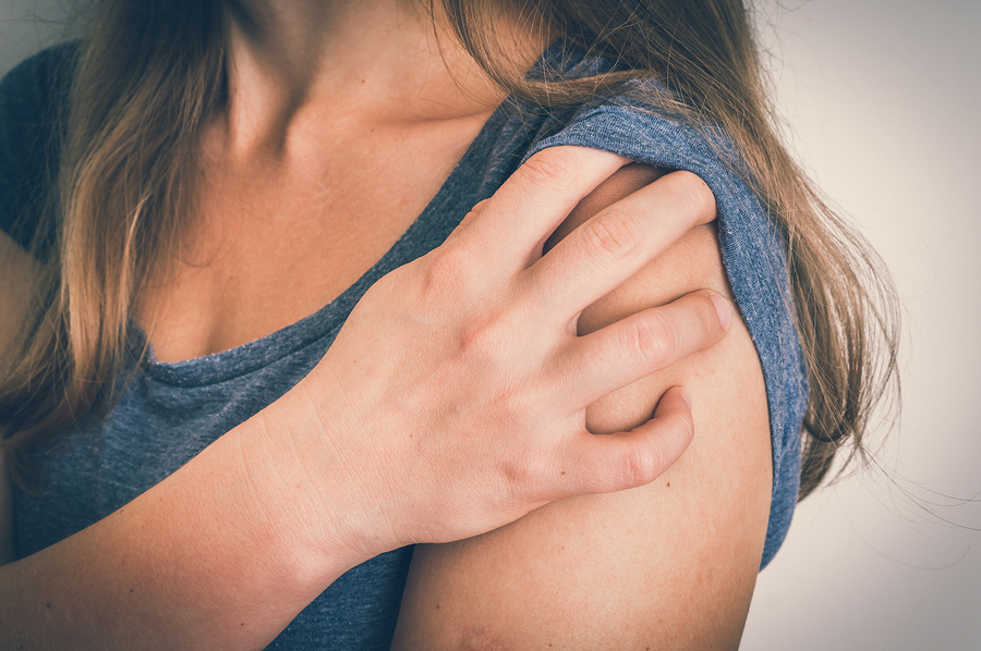 Woman With Shoulder Pain Is Holding Her Aching Arm – Body Pain C